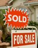Sold!. Real Estate Sign in front of a sold home royalty free stock photography