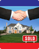 SOLD. Real Estate sold sign with red brick building stock images