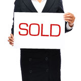 Sold. Businesswoman holding sold sign. Isolated on a withe background Stock Images