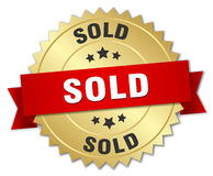 Sold 3d gold badge. With red ribbon Royalty Free Stock Photo