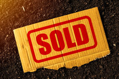 Sold first class arable farm land. Concept, selling the hectares of farmland for agricultural production Stock Photos