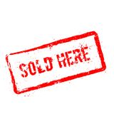 Sold here red rubber stamp isolated on white. Royalty Free Stock Image