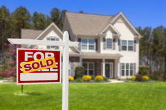 Sold Home For Sale Real Estate Sign and House Stock Image