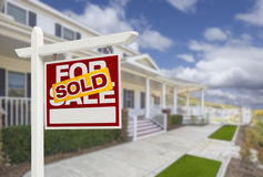 Sold Home For Sale Real Estate Sign and House Royalty Free Stock Images