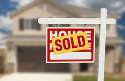 Sold Home For Sale Sign in Front of New House Stock Image