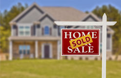 Sold Home For Sale Sign in Front of New House Stock Photography