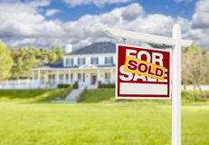 Sold Home For Sale Sign in Front of New House Royalty Free Stock Photography