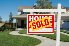Sold Home for Sale Sign and House Royalty Free Stock Images