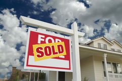 Sold Home For Sale Sign & New Home Stock Images