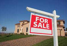 Sold Home For Sale Sign & New House Stock Image