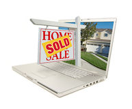 Sold Home for Sale Sign & New House on Laptop Stock Photo