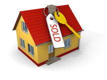 Sold house with key. Key with tag saying sold on small family house Royalty Free Stock Photos