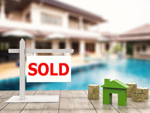 Sold house sign. With mock up house and gold coins royalty free stock images
