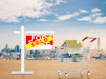 Sold house sign with mock up house in shopping cart Stock Photo