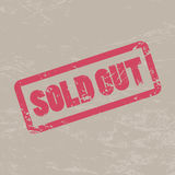 Sold out inscription in red frame on brown craft background. Stock Photos