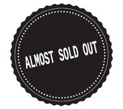 ALMOST-SOLD-OUT text, on black sticker stamp. Stock Photos