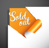 `Sold out` text uncovered from teared paper corner. Royalty Free Stock Images