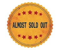 ALMOST-SOLD-OUT text, on vintage yellow sticker stamp. Royalty Free Stock Photography
