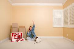 Sold Real Estate Signs, Boxes and Woman on Phone Royalty Free Stock Image