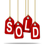 Sold Retail Price Tag Sign. Sale and selling retail price tag sign with the text sold as a red label with hanging strings tied to the paper commercial symbols of Stock Photography