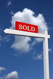 Sold sign. Real estate type sold sign with sky background stock image