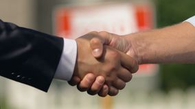 Sold sign behind handshaking owner and realtor, mortgage contract, investment. Stock footage stock footage