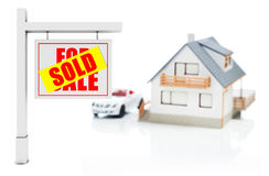 Sold sign in front of house Stock Images