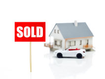 Sold sign in front of house Stock Photo