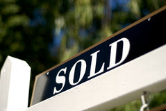Sold sign in front of house or condo Royalty Free Stock Image