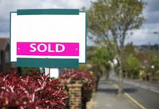 Sold sign for a house on a main road Royalty Free Stock Photo