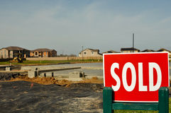 Sold Sign with new homes in the background Stock Photo