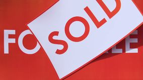 Sold sign over for sale sign, property exchange, real estate market, mortgage. Stock footage stock footage