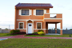 Sold Single family yellow orange  house. With cyan sky background Royalty Free Stock Photos