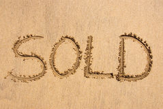 Sold written on sand Royalty Free Stock Image