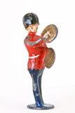 Soldado de brinquedo - protetor de marcha com pratos Imagens de Stock Royalty Free