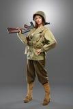 Soldado de la muchacha con la ametralladora Fotos de archivo libres de regalías
