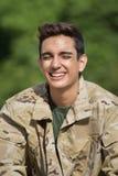Soldado de risa del varón del ejército Imagen de archivo