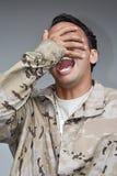 Soldado de sexo masculino apuesto Laughing Foto de archivo libre de regalías