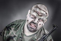 Soldado del zombi Imagenes de archivo