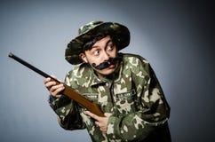 Soldado divertido contra Foto de archivo