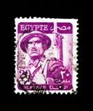 Soldado - ` inscrito da DEFESA do `, trabalhador, soldado, serie da mesquita, cerca de 1953 fotos de stock royalty free