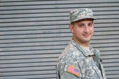 Soldado joven con la expresión sana amistosa Imagen de archivo libre de regalías