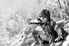 Soldado que tira del Pin Imágenes de archivo libres de regalías