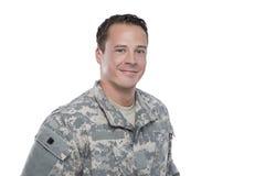 Soldado sonriente en el fondo blanco Foto de archivo