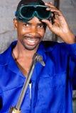 Soldador africano feliz Imagenes de archivo