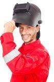 Soldador en guardapolvos rojos Imagen de archivo libre de regalías