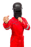 Soldador en guardapolvos rojos Fotos de archivo libres de regalías