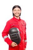 Soldador en guardapolvos rojos Fotografía de archivo