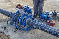 Soldadora del tubo para el tubo de agua de conexión Imagen de archivo libre de regalías