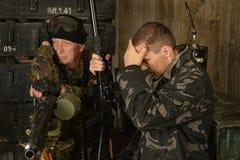 Soldados do combate armado Fotos de Stock Royalty Free